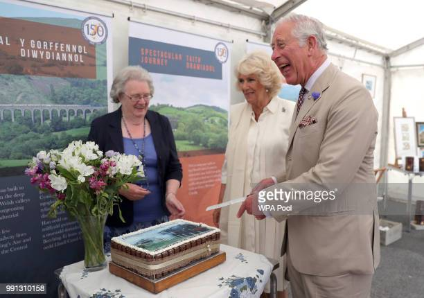 Prince Charles Prince of Wales and Camilla Duchess of Cornwall cuts the cake as they help mark the 150th anniversary of the Heart of Wales railway...