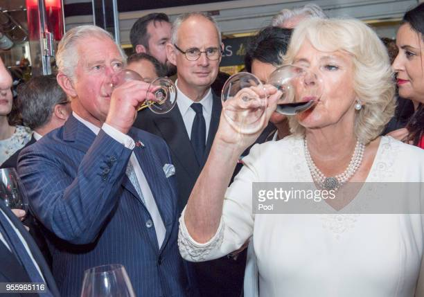 Prince Charles Prince of Wales and Camilla Duchess of Cornwall drink wine as they visit Les Halles de LyonPaul Bocuse food market on May 8 2018 in...