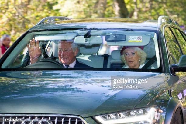 Prince Charles, Prince of Wales and Camilla Duchess of Cornwall drive to Crathie Kirk Church before the service on August 25, 2019 in Crathie,...
