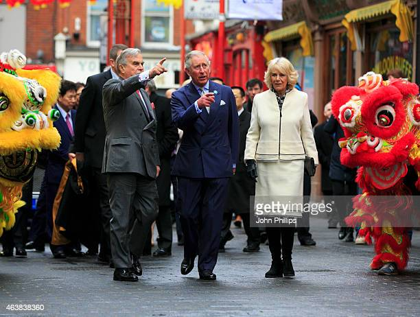 Prince Charles Prince of Wales and Camilla Duchess of Cornwall during an official visit to Chinatown to mark Chinese New Year at Chinatown on...