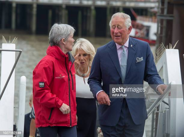 Prince Charles Prince of Wales and Camilla Duchess of Cornwall enjoy a joke with the original skipper Tracy Edwards MBE during their visit to the...