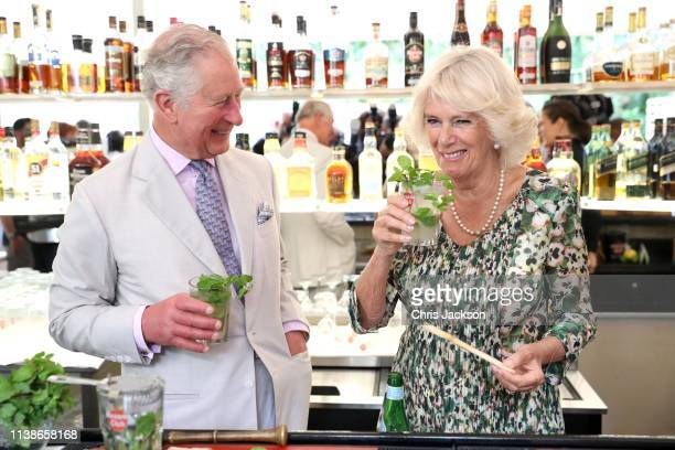 Prince Charles Prince of Wales and Camilla Duchess of Cornwall enjoy a mojito as they visit a paladar called Habanera a privately owned restaurant on...