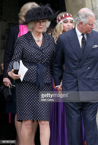 Prince Charles Prince of Wales and Camilla Duchess of Cornwall follow the coffin of Mark Shand as it leaves Holy Trinity Church in Stourpaine on May...
