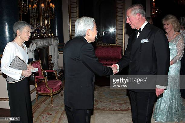 Prince Charles Prince of Wales and Camilla Duchess of Cornwall greet Emperor Akihito of Japan and Empress Michiko as they arrive for a dinner for...