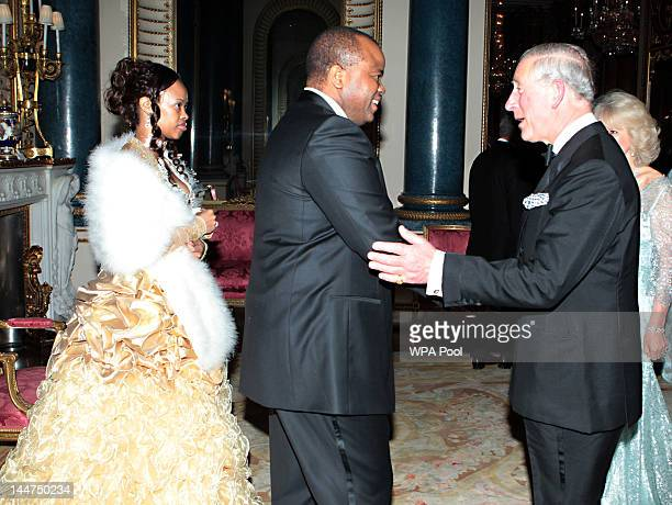 Prince Charles Prince of Wales and Camilla Duchess of Cornwall greet King Mswati III of Swaziland and wife Inkhosikati LaMbikiza of Swaziland as they...
