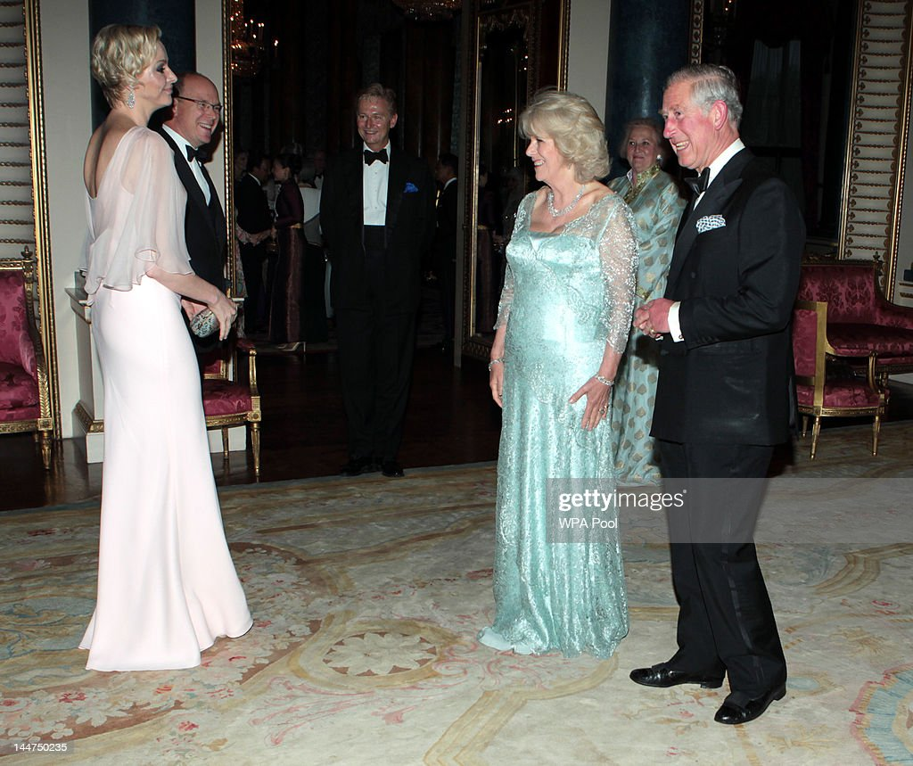 Prince Charles, Prince of Wales and Camilla, Duchess of Cornwall greet Prince Albert II of Monaco and Princess Charlene of Monaco as they arrive for a dinner for foreign Sovereigns to commemorate the Diamond Jubilee at Buckingham Palace on May 18, 2012 in London, England. Prince Charles, Prince of Wales and Camilla, Duchess of Cornwall hosted the event.