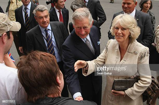 Prince Charles Prince of Wales and Camilla Duchess of Cornwall greet members of the public outside the British Embassy on April 29 2009 in Berlin...