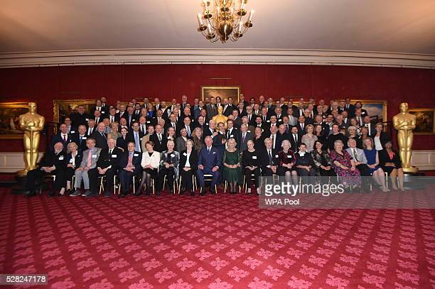 Prince Charles Prince of Wales and Camilla Duchess of Cornwall have their picture taken with British Oscar winners during a reception at St James's...