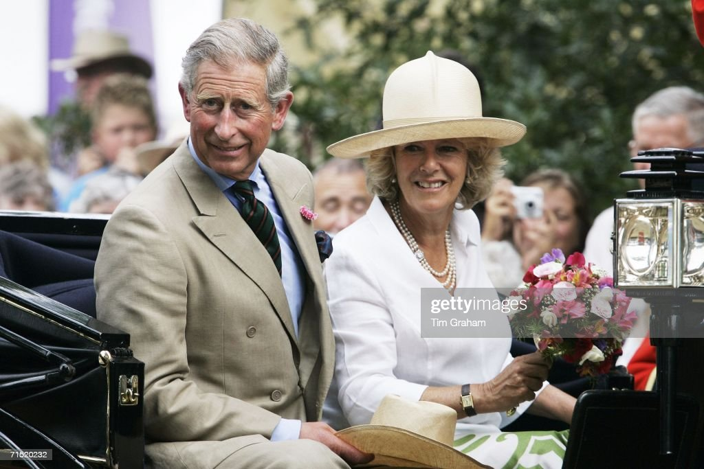 Prince Charles, Prince of Wales and Camilla, Duchess of Cornwall in an open carriage at the Sandringham Flower Show on July 26, 2006 in Norfolk, England.