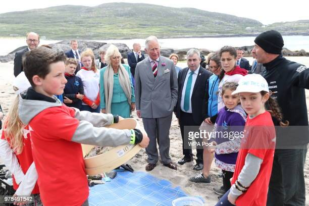 Prince Charles Prince of Wales and Camilla Duchess of Cornwall alongside Irish government minister Kevin 'Boxer' Moran meet local schoolchildren...