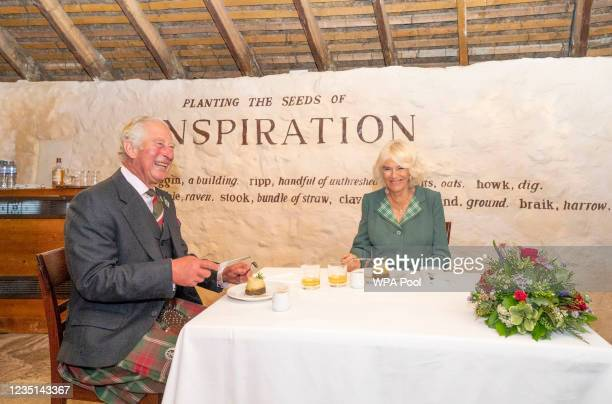 Prince Charles, Prince of Wales and Camilla, Duchess of Cornwall, known as the Duke and Duchess of Rothesay when in Scotland, are served haggis,...