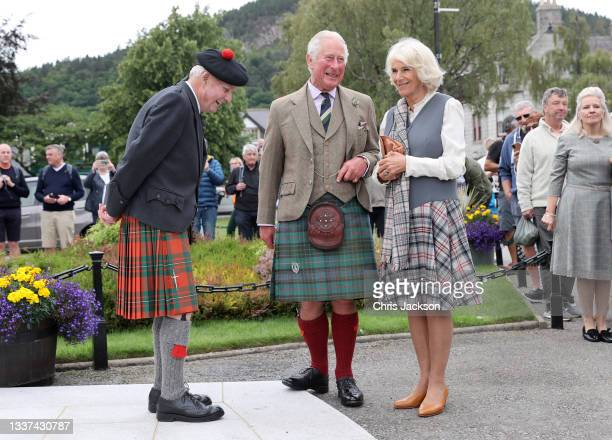 Prince Charles, Prince of Wales and Camilla, Duchess of Cornwall, known as the Duke and Duchess of Rothesay when in Scotland, speak with 90-year-old...