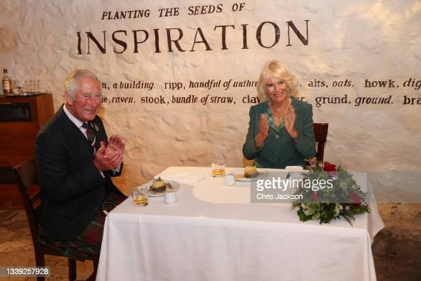 Prince Charles, Prince of Wales and Camilla, Duchess of Cornwall, known as the Duke and Duchess of Rothesay when in Scotland, taste haggis and whisky...