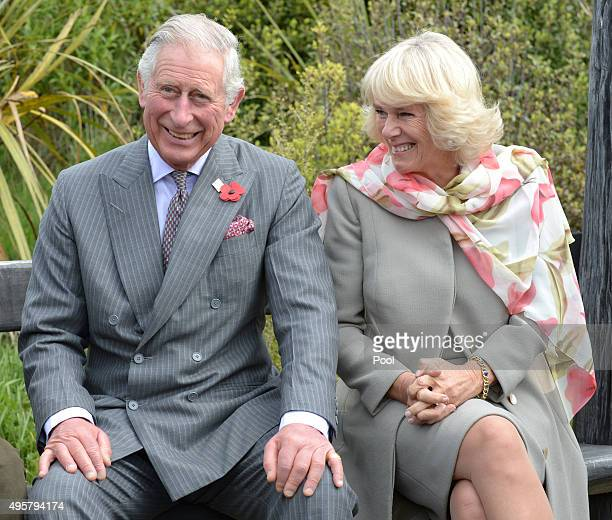 Prince Charles Prince of Wales and Camilla Duchess of Cornwall laugh during a visit to the Orokonui Ecosanctuary on November 5 2015 in Dunedin New...