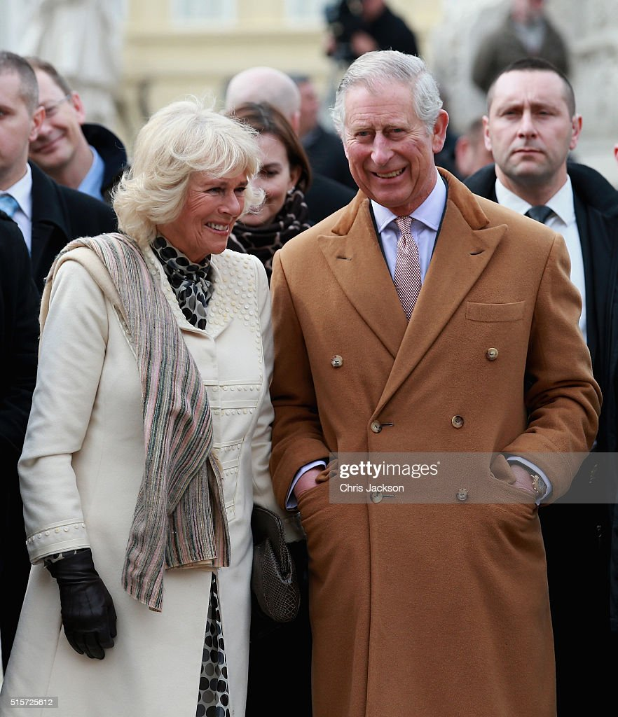 Prince Charles, Prince of Wales and Camilla, Duchess of Cornwall laugh as they watch traditional Croation Dancers in the town square on March 15, 2016 in Osijek, Croatia. The Prince and the Duchess are on the second day of a two day visit to Croatia.