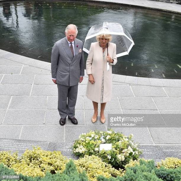 Prince Charles Prince of Wales and Camilla Duchess of Cornwall lay a wreath to mark the 20th anniversary of the Omagh bombing at Memorial Garden and...