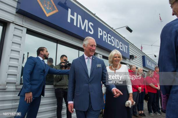 Prince Charles Prince of Wales and Camilla Duchess of Cornwall leave HMS President after their visit to the newly refurbished 'Maiden' Yacht on...