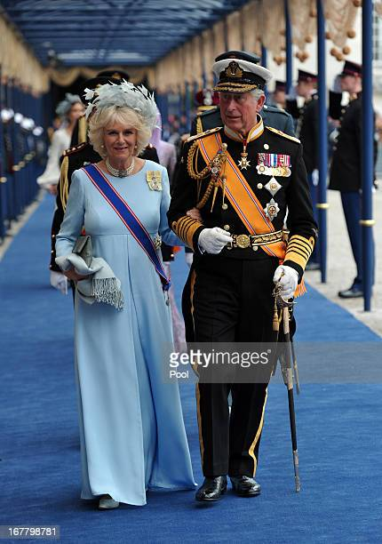 Prince Charles, Prince of Wales and Camilla, Duchess of Cornwall leave following the inauguration ceremony for HM King Willem Alexander of the...