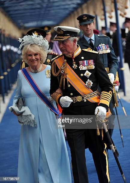 Prince Charles Prince of Wales and Camilla Duchess of Cornwall leave following the inauguration ceremony for HM King Willem Alexander of the...