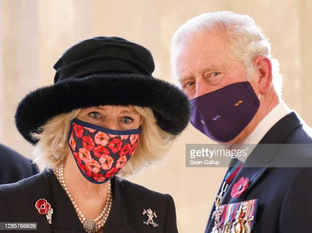 Prince Charles, Prince of Wales and Camilla, Duchess of Cornwall, look back after visiting the Neue Wache memorial to victims of war and tyranny on...
