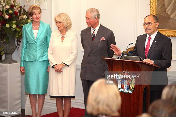 Prince Charles Prince of Wales and Camilla Duchess of Cornwall look on during his 64th birthday celebrations as GovernorGeneral of New Zealand Sir...