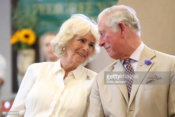 Prince Charles, Prince of Wales and Camilla, Duchess of Cornwall look at eachother as they reopen the newly-renovated Edwardian community hall The...
