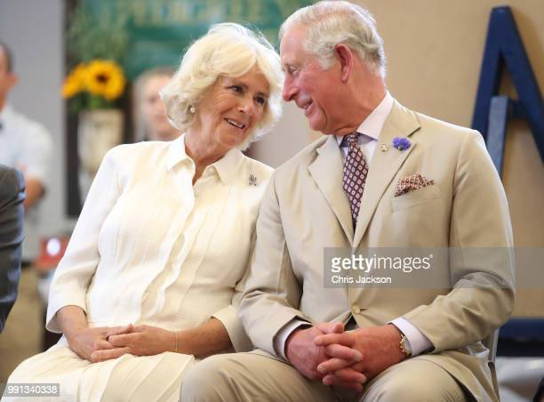 Prince Charles Prince of Wales and Camilla Duchess of Cornwall look at eachother as they reopen the newlyrenovated Edwardian community hall The...