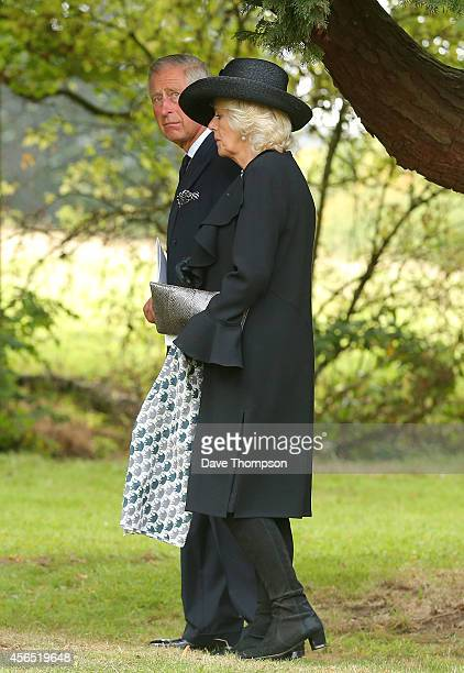Prince Charles Prince of Wales and Camilla Duchess of Cornwall make their way to the burial plot following the funeral of Deborah Dowager Duchess of...