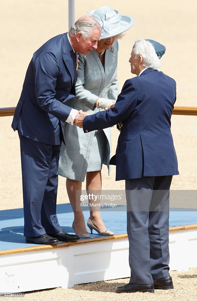Prince Charles, Prince of Wales and Camilla, Duchess of Cornwall meet a World War II Veteran taking part in a March Past to mark the 70th Anniversary of VE Day at Horse Guards Parade on May 10, 2015 in London, England.