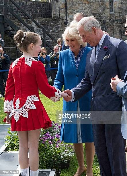 Prince Charles Prince of Wales and Camilla Duchess of Cornwall meet a young Irish dancer as they visit Donegal Castle on May 25 2016 in Letterkenny...