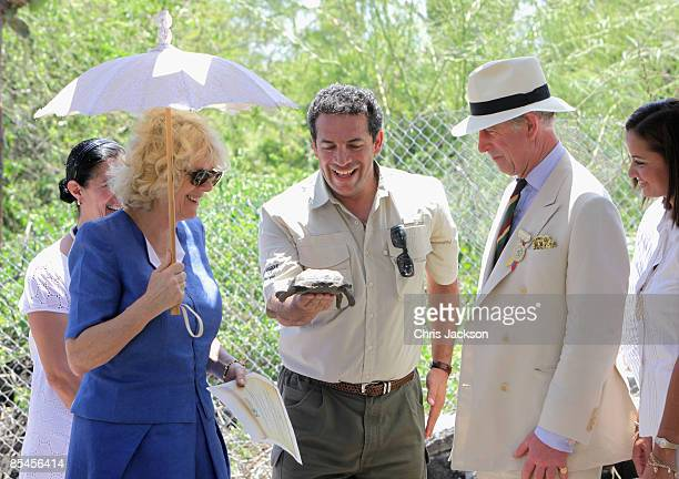 Prince Charles Prince of Wales and Camilla Duchess of Cornwall meet a tortoise they dubbed William during a tour of the Darwin Research Station on...