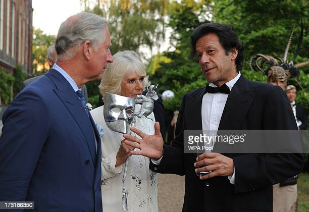 Prince Charles Prince of Wales and Camilla Duchess of Cornwall meet with politician and former cricketer Imran Khan as they host a reception for the...