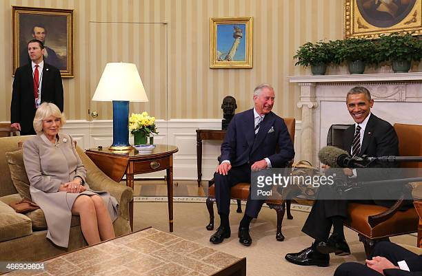 Prince Charles Prince of Wales and Camilla Duchess of Cornwall meet US President Barack Obama and US Vice President Joe Biden in the Oval Office in...