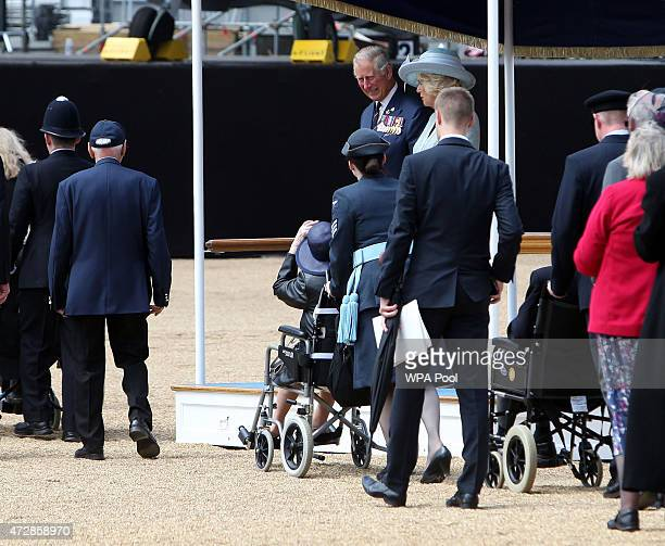 Prince Charles Prince of Wales and Camilla Duchess of Cornwall meet veterans during the VE Day Parade to mark the 70th anniversary of VE Day at Horse...