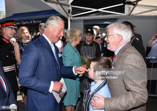 Prince Charles Prince of Wales and Camilla Duchess of Cornwall meet loacls as they visit the village market on May 10 2017 in Dromore Northern...