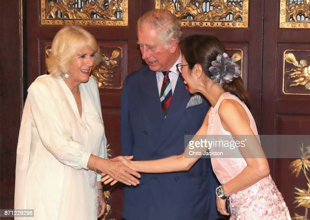 Prince Charles Prince of Wales and Camilla Duchess of Cornwall meet Malaysian actress Michelle Yeoh as they arrive at Penang's Peranakan Mansion to...