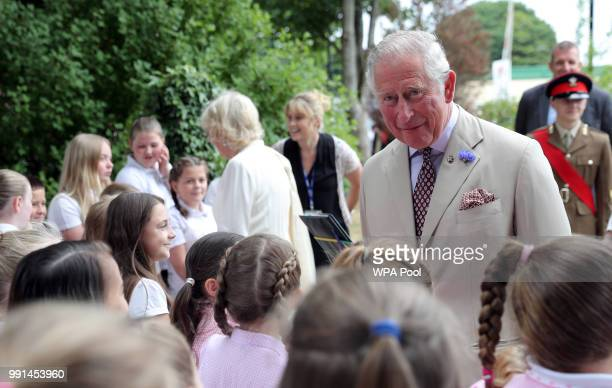 Prince Charles Prince of Wales and Camilla Duchess of Cornwall meets children as they mark the 150th anniversary of the Heart of Wales railway line...