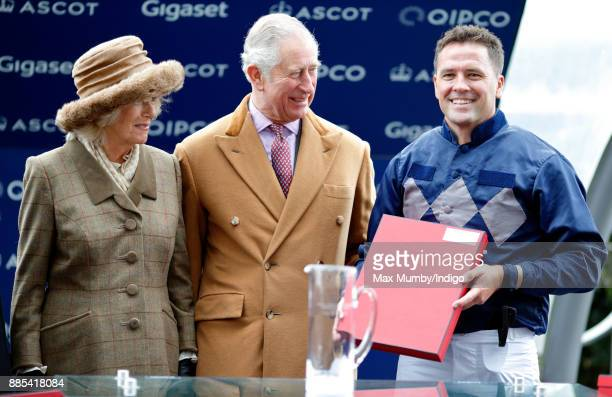 Prince Charles Prince of Wales and Camilla Duchess of Cornwall present Michael Owen with his prize for coming second in the The Prince's Countryside...