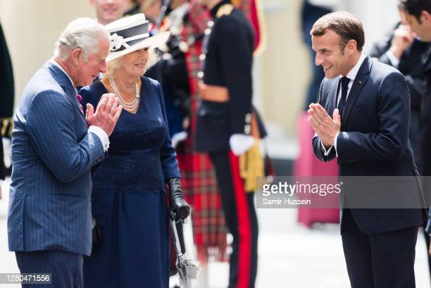 Prince Charles Prince of Wales and Camilla Duchess of Cornwall receive French President Emmanuel Macron during a ceremony at Carlton Gardens on June...