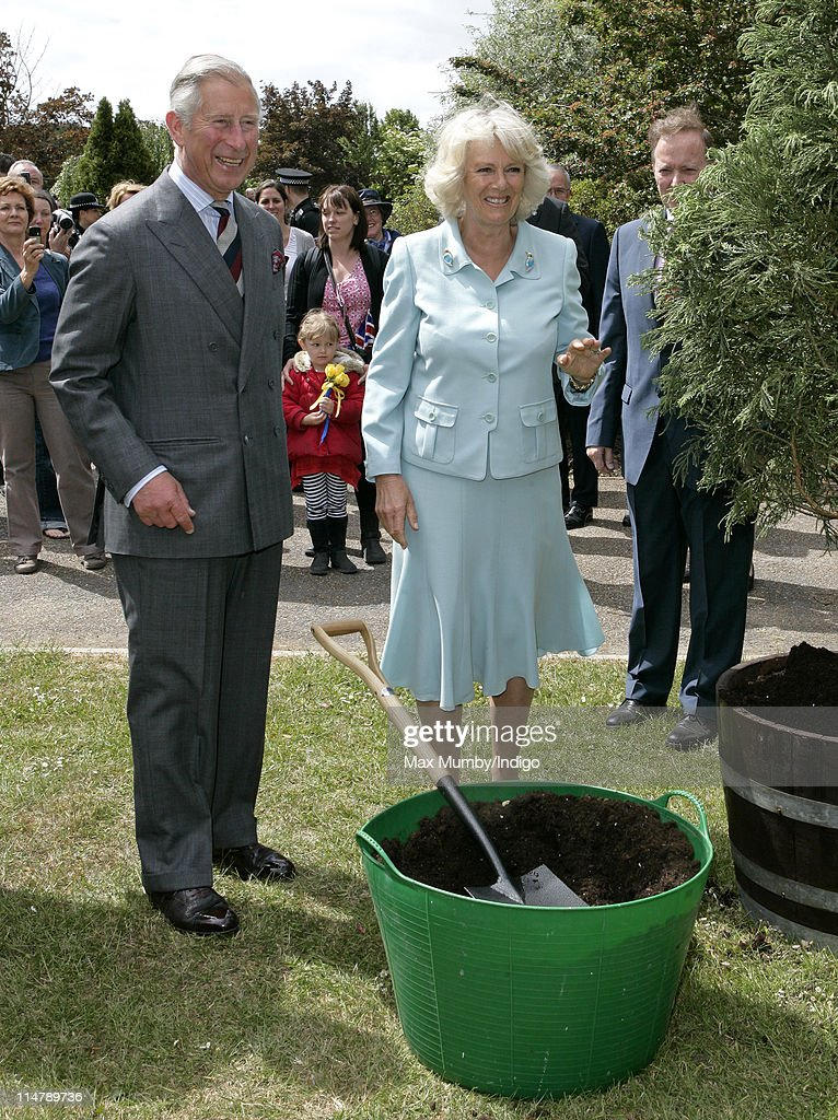 Prince Charles, Prince of Wales and Camilla, Duchess of Cornwall plant a tree during a visit to Denbies Wine Estate on May 26, 2011 in Dorking, England.