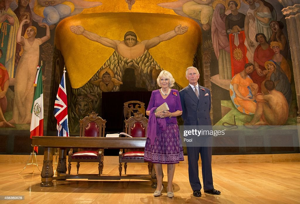 Prince Charles, Prince of Wales and Camilla, Duchess of Cornwall pose in front of a Diego Rivera mural after signing the visitor's book at the launch of 'The Year of the UK in MExico 2015' at San Ildefonso College on November 3, 2014 in Mexico City, Mexico. The Royal Couple are on the second day of a four day visit to Mexico as part of a Royal tour to Colombia and Mexico.