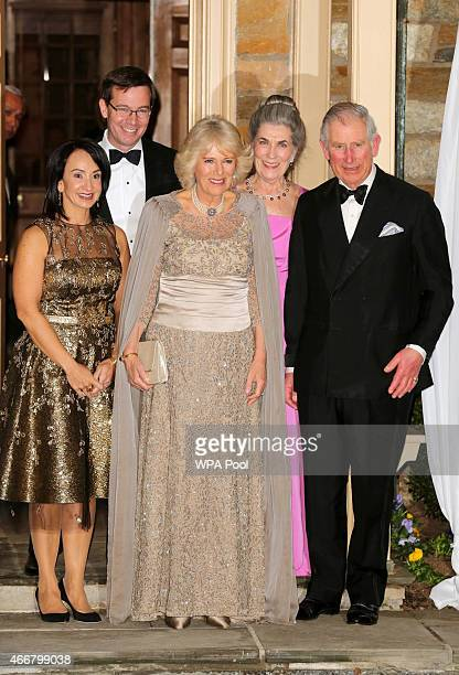 Prince Charles Prince of Wales and Camilla Duchess of Cornwall pose with Barbie Albritton Robert Albritton and Dr Elena Albritton as they arrive at...