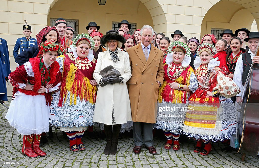 Prince Charles, Prince of Wales and Camilla, Duchess of Cornwall pose with traditional Croation Dancers in the town square on March 15, 2016 in Osijek, Croatia. The Prince and the Duchess are on the second day of a two day visit to Croatia.