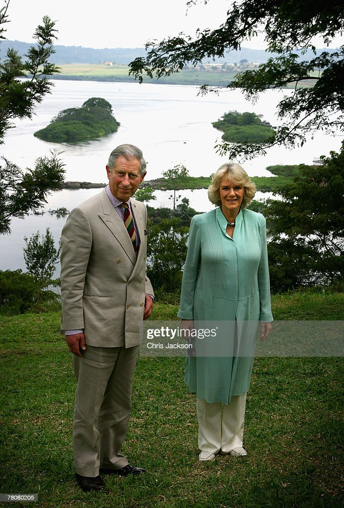 Prince Charles, Prince of Wales and Camilla, Duchess of Cornwall pose for a photograph on a riverbank at the source of the White Nile River on November 24, 2007 in Jinja, Uganda. The Prince and Duchess are in Uganda during the Commonwealth Heads of Govenment Meeting. CHOGM will be attended by over 5000 delegates, including Queen Elizabeth II and UK Prime Minister Gordon Brown.