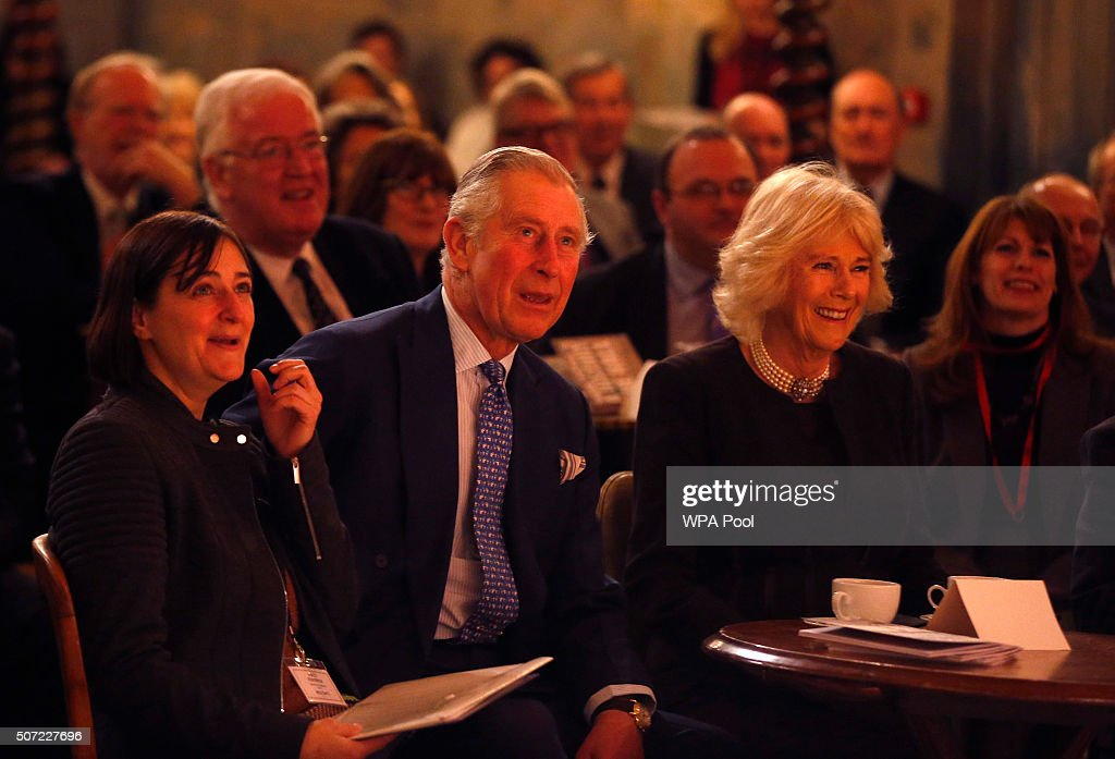 Prince Charles, Prince of Wales and Camilla, Duchess of Cornwall react as they watch an act on stage at Wilton's Music Hall, as he officially opens the venue on January 28, 2016 in London, England. The Duke and Duchess will meet with historians and architects involved in the venue's recent repair project.