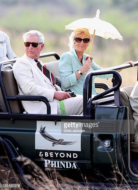 Prince Charles Prince of Wales and Camilla Duchess of Cornwall ride in a safari vehicle as they spot rhino in the Phinda Game Reserve on the third...