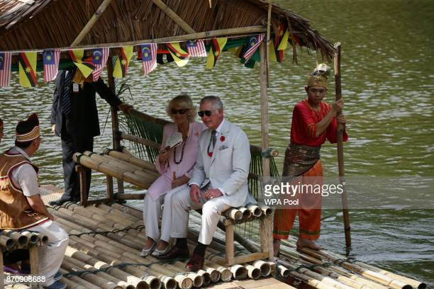 Prince Charles Prince of Wales and Camilla Duchess of Cornwall ride on a traditional raft across a lake as they leave after a visit to Sarawak...