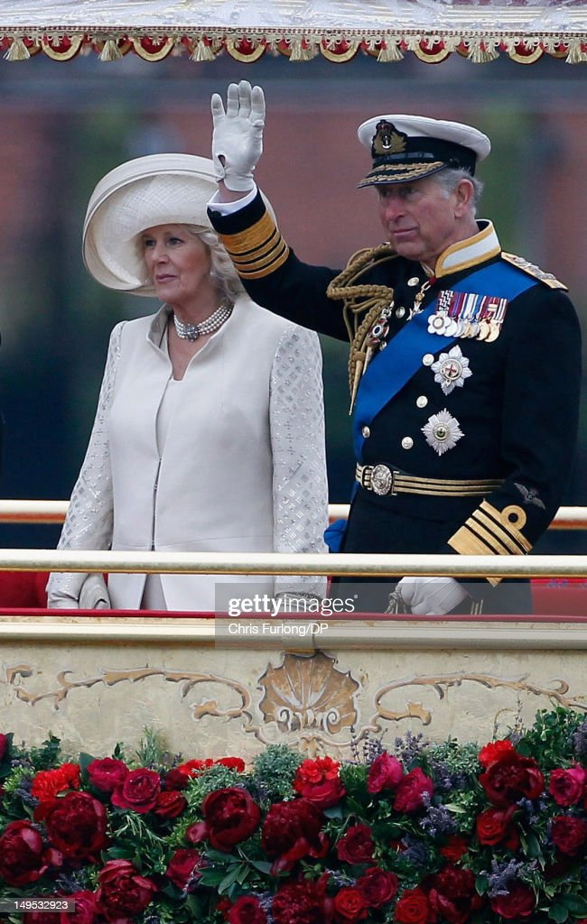 Prince Charles, Prince of Wales and Camilla, Duchess of Cornwall sail on the royal barge 'The Spirit of Chartwell' during the Thames Diamond Jubilee River Pageant during the Thames Diamond Jubilee River Pageant on June 3, 2012 in London, England. For only the second time in its history the UK celebrates the Diamond Jubilee of a monarch. Her Majesty Queen Elizabeth II celebrates the 60th anniversary of her ascension to the throne. Thousands of well-wishers from around the world have flocked to London to witness the spectacle of the weekend's celebrations. The Queen along with all members of the royal family will participate in a River Pageant with a flotilla of a 1,000 boats accompanying them down The Thames.
