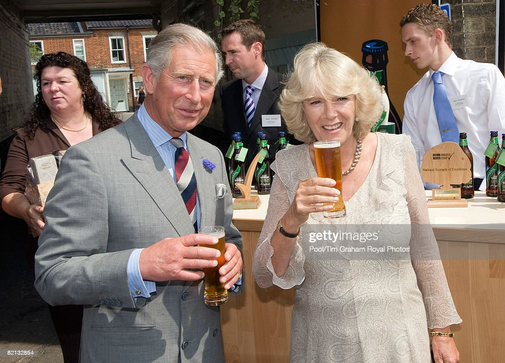 Prince Charles, Prince of Wales and Camilla, Duchess of Cornwall sample carbon neutral beer outside The Swan Hotel during a visit to Southwold on July 31, 2008 in Southwold, England.