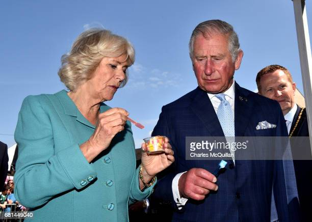 Prince Charles Prince of Wales and Camilla Duchess of Cornwall share an ice cream on their visit to the village market on May 10 2017 in Dromore...